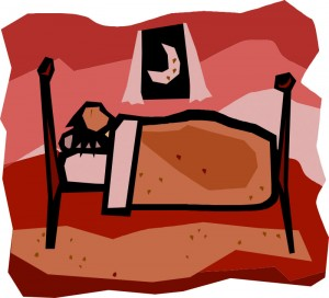 Sleeping person in a cozy bed
