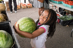 small girl with big melon